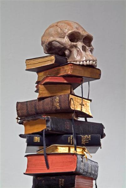 <span>All The Way Down (detail)</span><br />2009 - 93&quot x 23&quot x 23&quot - bibles, Australopithecus africanus skull cast, mixed media