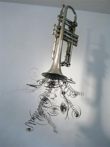 <span>Triple C</span><br />2014 - 30&quot x 16&quot x 12&quot - cornet, springs, guitar strings, human teeth, mixed media